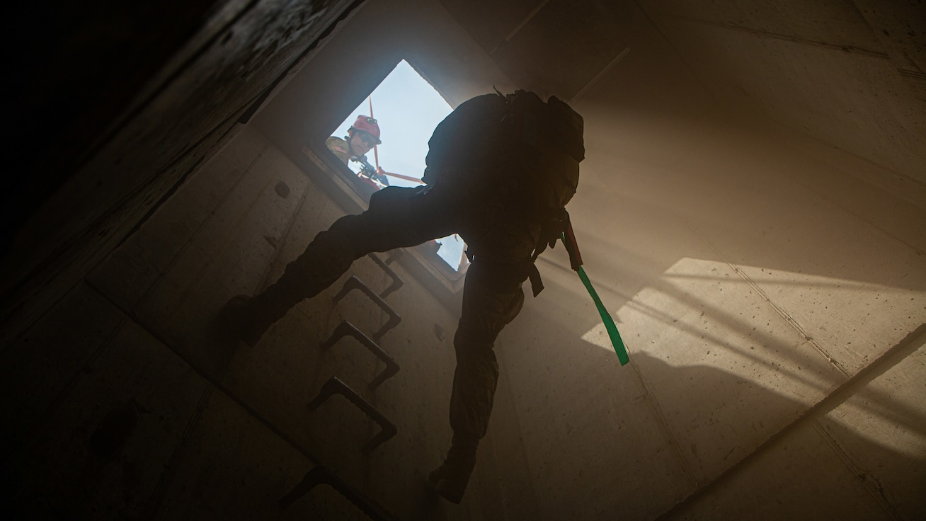 INDIANAPOLIS, Ind. – Airmen 1st Class Philip Nelson, a triage medic with the 19th CBRN Enhanced Response Force Package, ropes into a tunnel entrance in order to retrieve a casualty during a live exercise for United Front VIII at Muscatatuck Urban Training Center June 2, 2019.