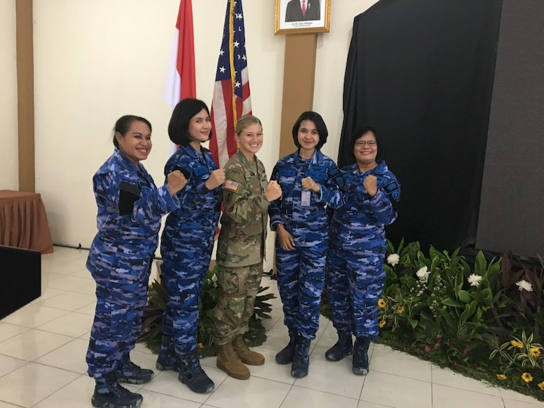 U.S. Army Pacific Capt. Lacey Sovern, Apache pilot, Assistant Operations Officer, 25th Combat Aviation Brigade, takes a group photo with Indonesian Air Force doctors and nurses. (Courtesy Photo)