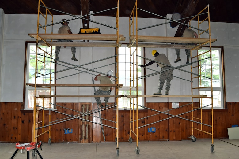 Carpenters of the 127th Civil Engineering Squadron hang and mud drywall during a renovation project at Fort Indiantown Gap National Guard Training Center, Annville, Pennsylvania, on July 22, 2019.