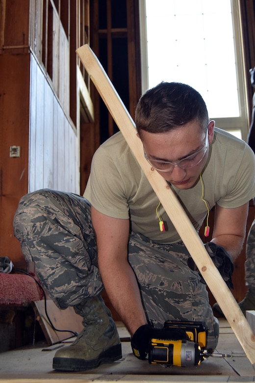 Airman 1st Class Paul Prohaszka, a carpenter with the 127th Civil Engineering Squadron out of Selfridge Air National Guard Base, Michigan,, builds a saw horse during a renovation project at Fort Indiantown Gap, Annville, Pennsylvania, on July 22, 2019.