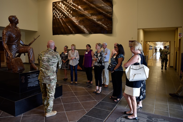 U.S. Air Force Master Sgt. Chris Trisko, 351st Special Warfare Training Squadron operations superintendent, talks to honorary commanders about the history of pararescue.