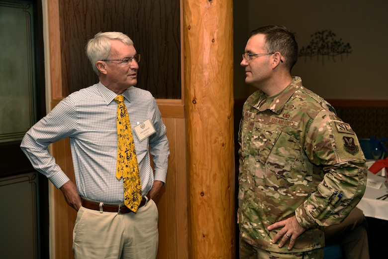 U.S. Air Force Col. Theodore Breuker, 377th Security Forces Group commander, talks with John Rockwell, 377th SFG honorary commander.