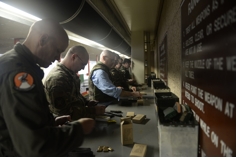 William P. McEvoy, 18th Wing History office chief, loads rouns into the magazine of an M9 pistol during qualification training June 24, 2019, at Kadena Air Base, Japan. McEvoy recently deployed to Southeast asia in support of operations occuring there. (U.S. Air Force photo by Staff Sgt. Benjamin Sutton)
