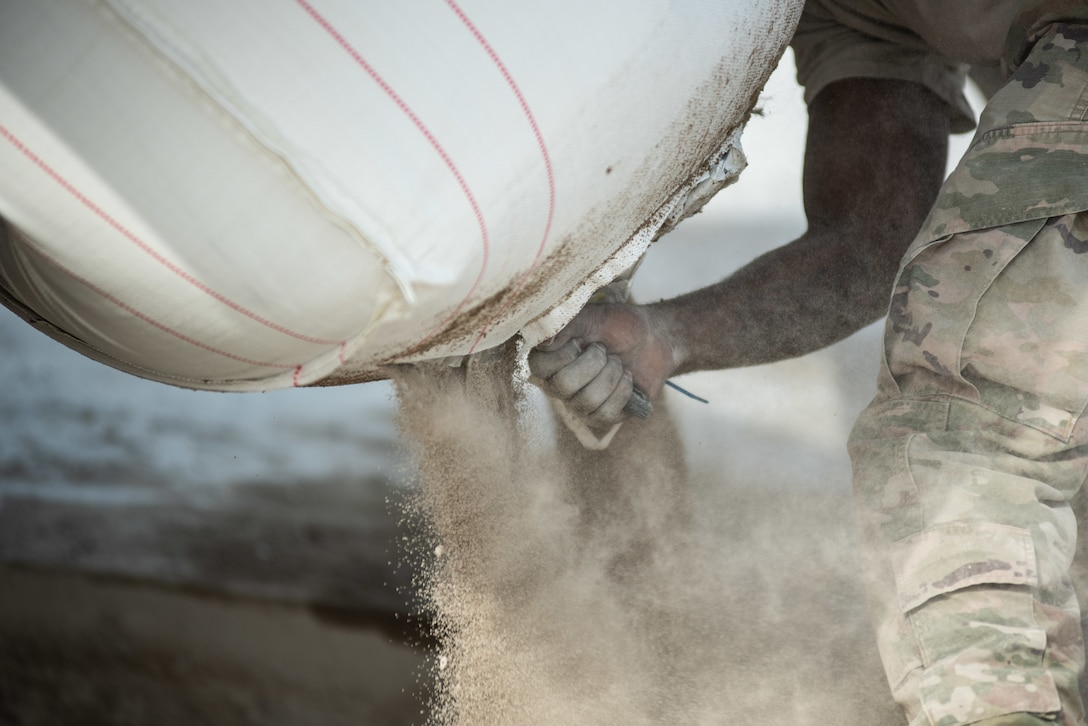 A 380th Expeditionary Civil Engineer Squadron Dirt Boy cuts open a fast-curing concrete package during a rapid airfield damage repair exercise July 26, 2019, at Al Dhafra Air Base, United Arab Emirates. RADR allows aircraft to start utilizing what was once a damaged airfield in a matter of hours compared to days with traditional repair methods. (U.S. Air Force photo by Staff Sgt. Chris Thornbury)