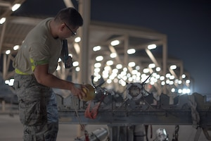 Airman 1st Class Jose Lopez, 380th Expeditionary Aircraft Maintenance Squadron weapons load crew team member, inspects an AIM-9X Sidewinder missile July 15, 2019, at Al Dhafra Air Base, United Arab Emirates. The AIM-9X is an advanced infrared missile and the newest of the Sidewinder family of short-range air-to-air missiles carried on a wide range of fighter jets. (U.S. Air Force photo by Staff Sgt. Chris Thornbury)