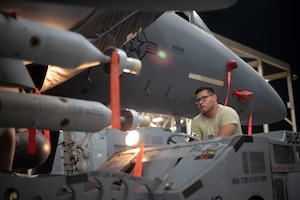 Airman 1st Class Jose Lopez, 380th Expeditionary Aircraft Maintenance Squadron weapons load crew team member, drives a GBU-12 under an F-15E Strike Eagle July 15, 2019, at Al Dhafra Air Base, United Arab Emirates. The F-15E has the capability to carry any air-to-surface weapon in the Air Force inventory. (U.S. Air Force photo by Staff Sgt. Chris Thornbury)