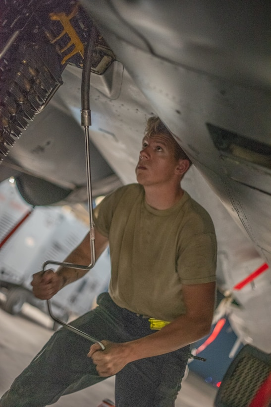 Senior Airman Sean Logan, 380th Expeditionary Aircraft Maintenance Squadron weapons load crew team member, loads an F-15E Strike Eagle with 20mm high-explosive incendiary bullets July 15, 2019, at Al Dhafra Air Base, United Arab Emirates. Weapons load crews work 24/7 operations to support loading and configuring various munitions for the F-35A Lightning II, F-15E Strike Eagle and F-15C Eagle jets at ADAB. (U.S. Air Force photo by Staff Sgt. Chris Thornbury)