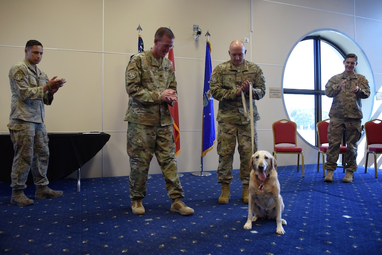 39th Security Forces Squadron Airmen congratulate Autumn, a military working dog, upon her retirement at Incirlik Air Base, Turkey, July 29, 2019. The practice of using utility dogs for warfare dates back thousands of years, as seen in evidence from the Ancient Romans and Egyptians. (U.S. Air Force photo by Staff Sgt. Joshua Magbanua)