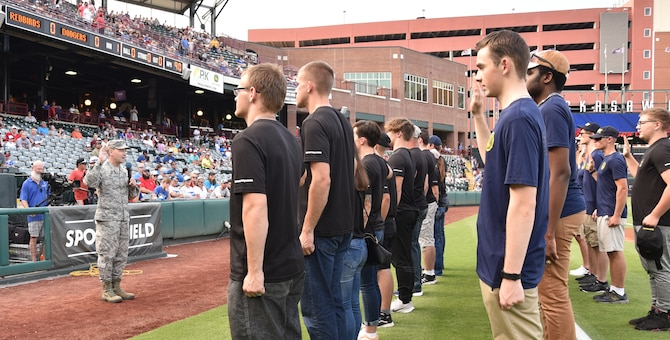 Col. Paul Filcek, 72nd Air Base Wing commander, administers the oath of enlistment during the Oklahoma City Dodgers game July 26 during Military Appreciation Night. (U.S. Air Force photo/Amy Schiess)