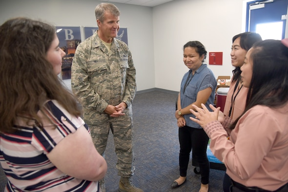 Interns with the 76th Software Engineering Group speak with Oklahoma City Air Logistics Complex Commander Br. Gen. Chris Hill during the 76th SWEG SU19 Internship pizza party in The Assembly room of Bldg. 9001 July 29. The internship program has doubled since last year with a total of 87 interns this summer. Twenty-nine of the interns are returning from previous years and are embedded within squadrons working on fielded projects. The remaining interns are participating in the 76SWEG's rotational internship program where they receive firsthand experience in what each squadron does. (U.S. Air Force photo/Kelly White)