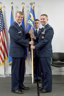 Oklahoma City Air Logistics Complex Commander Brig. Gen. Chris Hill presided over the Change of Command Ceremony for the 76th Commodities Maintenance Group in The Assembly room of Bldg. 9001 July 22. Col. Matthew Lewin assumed command of the group from Col. James Petrick. Lewin will be responsible for more than 2,000 maintenance professionals and 21 major production facilities providing manufacturing, repair, overhaul and testing of more than 75,000 aircraft and missile components. (U.S. Air Force photo/Kelly White)