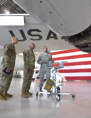 Chief Master Sgt. of the Air Force #18 Kaleth O. Wright visited several units at Tinker Air Force Base and toured the 137th Special Operations Wing at Will Rogers Air National Guard Base July 30-31. During his visit, Wright received an overview of Tinker missions with an emphasis on Airmen's contributions to readiness through innovation and their impact throughout the Air Force. Shown here, Staff Sgt. Kasey Vance, 552nd Maintenance Squadron, demonstrates improvements to an engine gearbox on an E-3 Sentry Airborne Warning and Control System aircraft. Wright also delivered a presentation focusing on Wingman and total force resiliency at an Enlisted All Call at Rose State College. (U.S. Air Force photo/Kelly White)