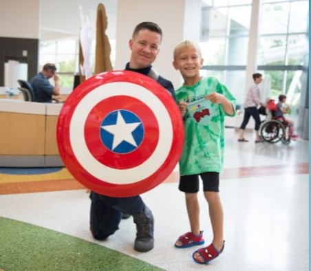 U.S. Air Force Tech. Sgt. Christopher Long, 87th Force Support Squadron base honor guard NCO in charge, volunteers to dress up as Captain America to give back to children and make them smile. (Courtesy photo)