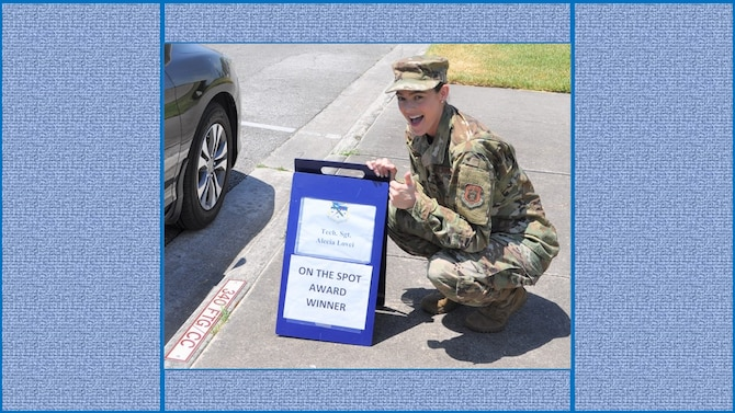 Tech. Sgt. Alecia Lovci, 340th Flying Training Group Undergraduate Flying Training program student administration specialist, claims her turn in the boss' parking slot following her selection as the July On-the-Spot Award winner. (U.S. Air Force photo by Janis El Shabazz)
