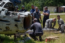 First Responders from multiple departments throughout South Carolina preform a lever technique on a downed aircraft aboard Marine Corps Air Station Beaufort, July 25. The lever technique is important for first responders because it doesn't require many resources to accomplish, training as a team helps keep our interoperability between departments high. (U.S. Marine Corps photo by Lance Cpl. Aidan Parker)