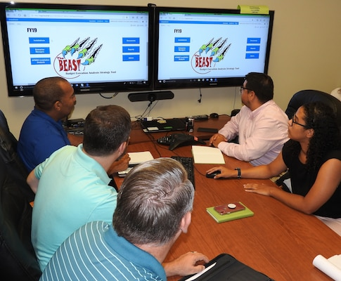 Members of the Air Force Installation and Mission Support Center's Budget Office Installation Support Team review the Budget Execution Analysis Strategy Tool, or BEAST, to monitor the status of must pay and unfunded requirements at installations across the Air Force.