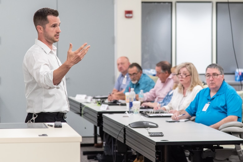 Kyle Shireman, a safety manager with the U.S. Army Engineering and Support Center, Huntsville, leads safety training in Huntsville, Alabama, July 24, 2019, for contractors who specialize in electronic security systems.
