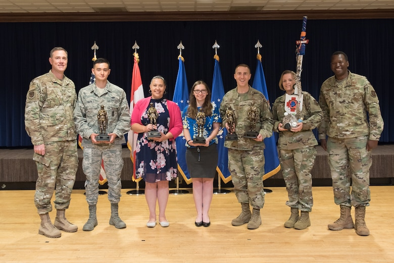 The 21st Space Wing celebrates its second quarter award winners during a breakfast at The Club on Peterson Air Force Base, Colorado, July 25, 2019. Members received awards in civilian of the quarter categories as well as company grade officer, senior noncommissioned officer, NCO and Airman of the quarter categories. (U.S. Air Force photo by Heather Heiney)