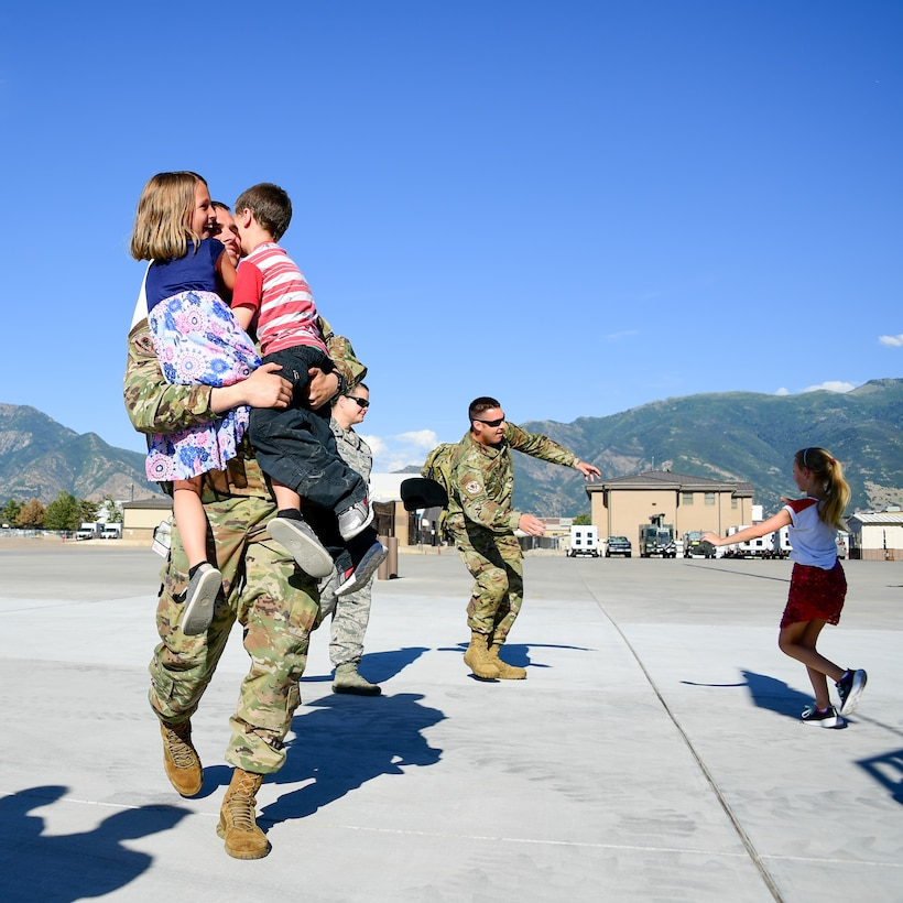 An Airman greets his family during the return of Airmen assigned to the 421st Fighter Squadron at Hill Air Force Base, Utah, July 30, 2019. The Airmen were stationed at Spangdahlem Air Base, Germany, for a 2-month European Theater Security Package. The 421st Fighter Squadron participated in several combat exercises with allied and partner nations while deployed. (U.S. Air Force photo by R. Nial Bradshaw)