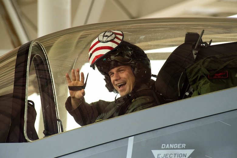 An F-35A Lightning II pilot with the 421st Fighter Squadron waves as he returns from a deployment to Hill Air Force Base, Utah, July 31, 2019. The 421st Fighter Squadron participated in several combat exercises with allied and partner nations while deployed to Europe. (U.S. Air Force photo by R. Nial Bradshaw)