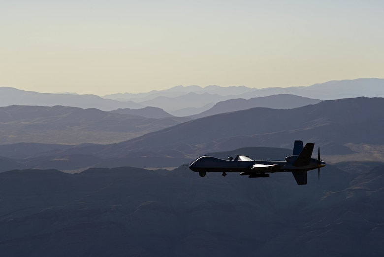An MQ-9 Reaper flies over Training Range
