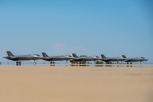 Five F-35A Lightning IIs line up before taking off