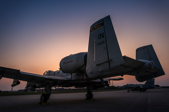 An A-10 Thunderbolt II sits on the flight line
