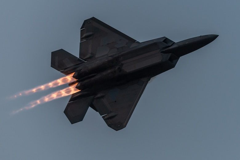 An F-22 flies a twilight demonstration