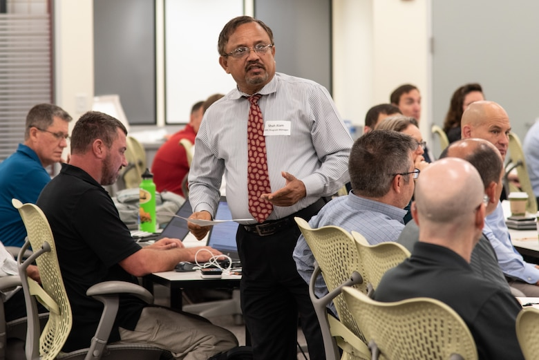 Shah Alam, Energy Savings Performance Contracting program manager with the U.S. Army Engineering and Support Center, Huntsville, covers introductions with a group of more than 70 contractors and government personnel attending a one-day joint workshop in Huntsville, Alabama, July 25, 2019. The group included representatives from the 13 energy-service companies that fall under Huntsville Center's Energy Savings Performance Contracting Indefinite Delivery/Indefinite Quantity Multiple Award Task Order.