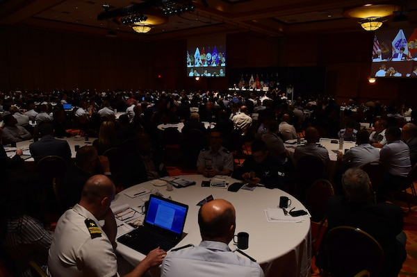 """The audience listens to a panel discussion on """"How Does Economic Entanglement Affect Competition and Deterrence?"""" at the 2019 United States Strategic Command Deterrence Symposium at La Vista Conference Center in La Vista, Neb., July 31, 2019. The military and industry panel participants include; Dr. Hilton Root, Professor, George Mason Schar School of Policy & Government, George Mason University; Dr. Jonathan Ward, Atlas Organization; Dr. Thomas Oatley, Professor & Corasaniti–Zondorak Chair in International Relations, Tulane University; Dr. Benn Steil, Senior Fellow and Director International Economics, Council on Foreign Relations; and Ms. Linda Specht, Political Advisor, U.S. Strategic Command. This annual symposium draws academic, government, military and international experts with the goal of creating a forum to explore a broad range of deterrence issues and thinking."""