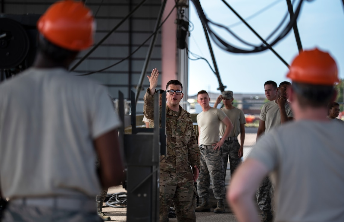 363rd Training Squadron munitions apprentice course students listen to their instructor at Sheppard Air Force Base, Texas, August 1, 2019. The munitions course is 43 days of training. In this time the students are taught how to handle, inspect and assemble bombs and other weapons. They work with all the safety precautions and gear as if really working with live munitions, as to get the students comfortable with working around dangerous objects. (U.S. Air Force photo by Air Force photo by Airman 1st Class Pedro Tenorio)
