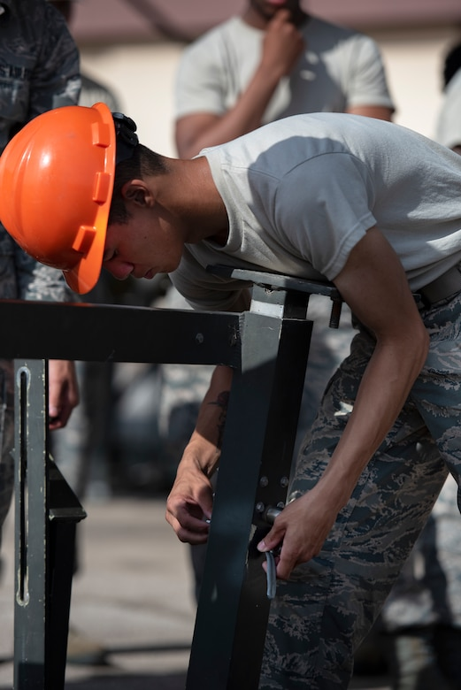 A 363rd Training Squadron munitions apprentice course assembles a munitions assembly conveyor at Sheppard Air Force Base, Texas, August 1, 2019. The MAC is used as a mobile assembly line making it easier to move and adjust munitions in a controlled environment. (U.S. Air Force photo by Air Force photo by Airman 1st Class Pedro Tenorio)