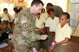 U.S. Army Capt. Devin Devries, who serves in the 351st Civil Affairs Command, as a civil affairs officer, goes through a practical exercise with students on the importance of proper hand washing during a civil and community outreach activity at Ululbau District School in Labasa, Fiji, July 31, 2019. Bilateral exercises, such as Exercise Cartwheel, strengthen our nations' capabilities to respond to crisis situations. The U.S. Army is committed to maintaining a long lasting relationship with its Fijian partners in the Pacific. (U.S. Army Photo by 1st Lt. Mark Sagvold)