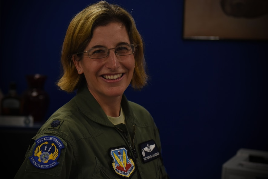 """Lt. Col. """"Spaz"""" Sposito-Salceies, 505th Test Squadron (TS) commander, stands behind her desk July 26, 2019, at Nellis Air Force Base, Nev."""