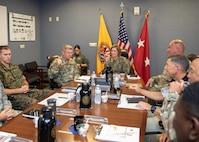 """U.S. Army North (ARNORTH) Commanding General Army Lt. Gen. Laura Richardson is briefed by Joint Task Force Civil Support (JTF-CS) Commanding General Maj. Gen. William """"Bill"""" Hall and the command's leadership during her visit to JTF-CS headquarter. During the visit, which is her first since assuming command of ARNORTH, Richardson toured the facility to learn about the command's capabilities and mission and received an operations brief with the command's leadership. (Official DoD photo by Mass Communication Specialist 3rd Class Michael Redd/RELEASED)"""