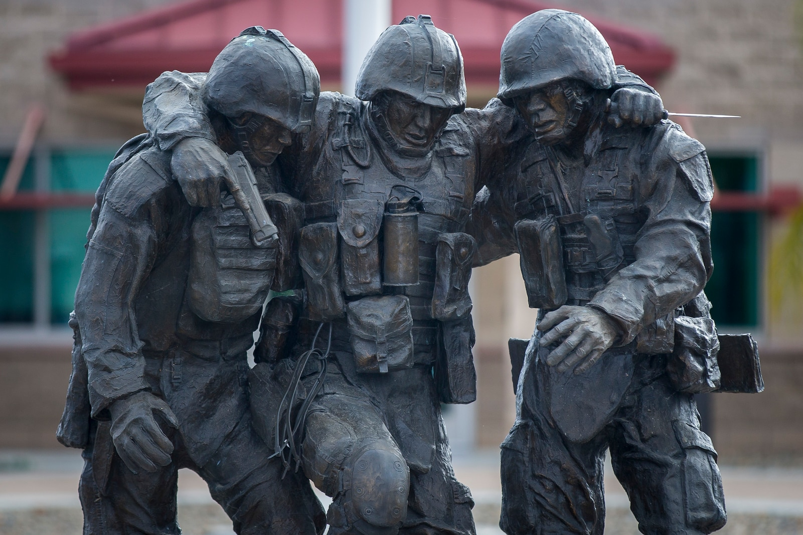 The commemorative statue of 1st Sgt. Bradley Kasal being carried by Lance Cpl. Chris Marquez and Lance Cpl. Dan Shaffer, after taking heavy fire, stands outside of the Wounded Warrior Battalion-West headquarters building on Marine Corps Base Camp Pendleton, Calif., June 1, 2018.  WWBn-W is committed to the successful recovery and transition of each Marine and family assigned to its care, and focuses on the mind, body and spirit of every individual when addressing recovery needs. (U.S. Marine Corps Cpl. Juan C. Bustos)