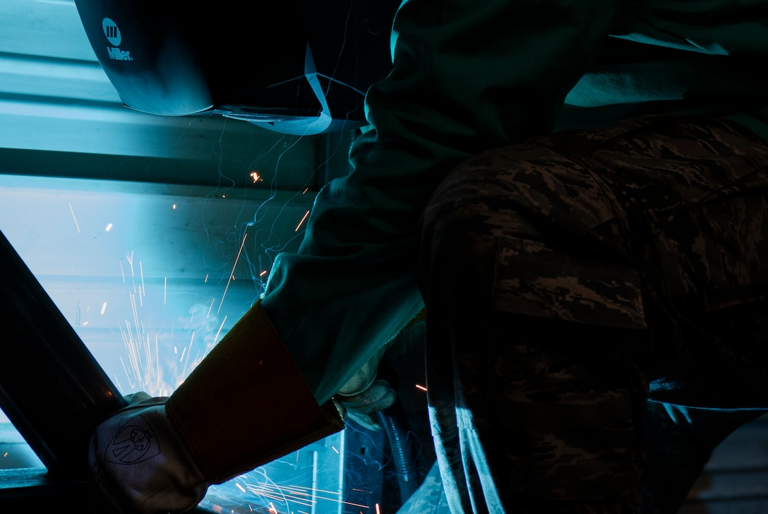 U.S. Air Force Airman 1st Class Dakota Montgomery, 20th Equipment Maintenance Squadron aircraft metals technology apprentice, uses a plasma cutter on a transport cart at Shaw Air Force Base, South Carolina, July 30, 2019.