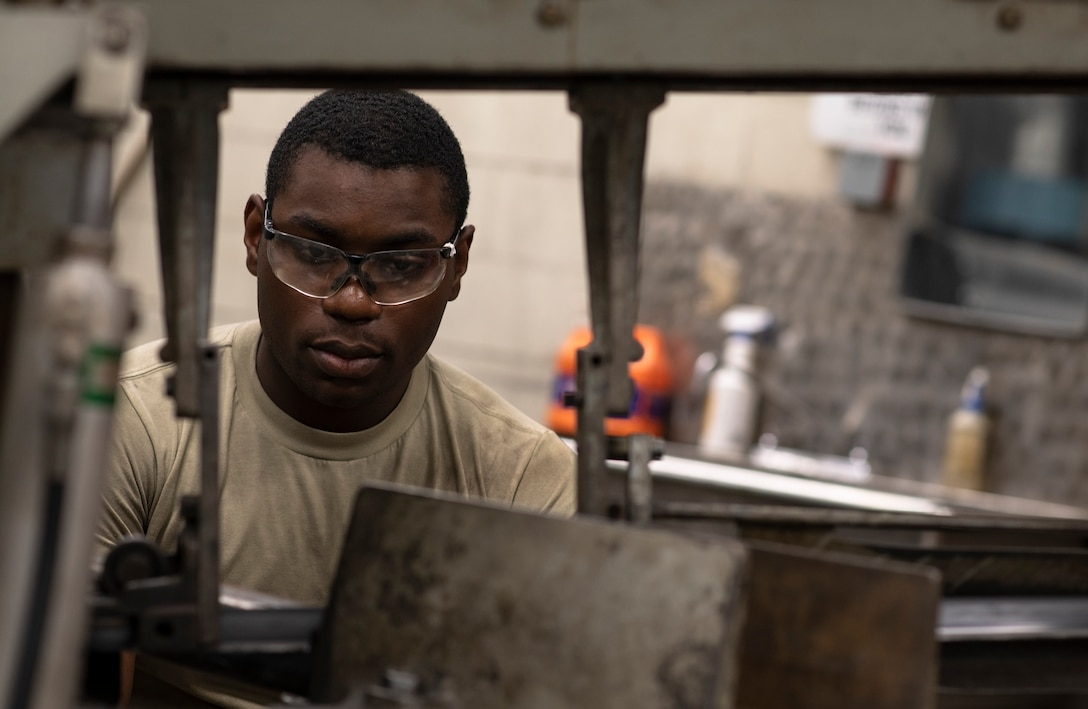 U.S. Air Force Airman 1st Class Tylique McMichael, 20th Equipment Maintenance Squadron aircraft metals technology apprentice, works on a piece of metal at Shaw Air Force Base, South Carolina, July 30, 2019.
