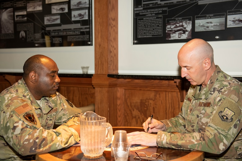 Chief Master Sgt. John Kirby, U.S. Air Forces Central Command (AFCENT) A3 aircraft control function manager, right, advises Master Sgt. Ernest Wheeler, U.S. AFCENT A6XR, section chief on his Enlisted Program Report (EPR) during a speed mentoring session at the 20th Force Support Squadron Carolina Skies Club, Shaw Air Force Base, South Carolina, July 30, 2019.
