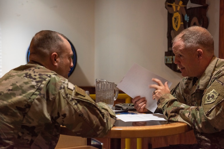 Chief Master Sgt. Russel Boseman, Aircraft Maintenance Squadron maintenance chief (right) advises an Airmen on his Enlisted Program Report (EPR) during a speed mentoring session at the Carolina Skies Club, Shaw Air Force Base, South Carolina, July 30, 2019.