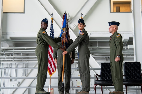 U.S. Air Force Lt. Col. Menola Guthrie, the 50th ARS commander, accepts the guidon from Col. Travis Edwards, the 6th Operations Group commander during a change of command ceremony, Aug. 2, 2019, at MacDill Air Force Base, Fla. Guthrie's appointment as the 50th ARS commander, marks her second command assignment, having previously served as the 28th Expeditionary Air Refueling Squadron commander, at Al Udeid Air Base, Qatar from April 2018 to August 2018. (U.S. Air Force photo by Airman 1st Class Shannon Bowman)