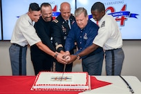 From left, Cadet Capt. Christian Falk, U.S. Military Academy; James Skibo, Exchange senior vice president; Maj. Gen. David C. Coburn, U.S. Army Financial Management Command commanding general; Tom Shull, Exchange director and CEO; and Cadet Capt. Thomas Bordeaux, U.S. Military Academy, cut a ceremonial cake in celebration of the Exchange's 124th anniversary. As the Department of Defense's largest retailer, the Exchange has a commitment to taking care of warfighters, no matter where their mission takes them.