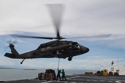 U.S. Navy sailors aboard the U.S.N.S. Comfort attach a load of medical equipment and supplies to a UH-60 Balckhawk to be transported to Punta Arenas, Costa Rica, July 21, 2019. Pilots and aircrew assigned to the 1st Battalion, 228th Aviation transported personnel and equipment to allow the U.S. Naval Ship Comfort to provide medical care to Costa Rican citizens and Venezuelan migrants as part of the United States enduring promise of helping its southern neighbors. The Winged Warriors transported more than 470 people and 20 tons of cargo from July 21 - 30. (U.S. Air Force photo by Staff Sgt. Eric Summers Jr.)