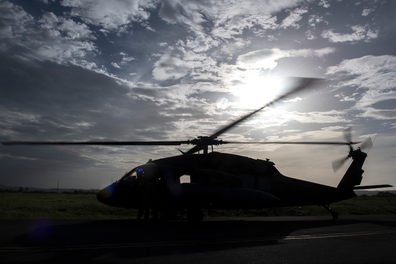 A UH-60 Blackhawk, assigned to the 1st Battalion, 228th Aviation Regiment, shuts down after completing a day of sling loading equipment and transporting personnel on the U.S.N.S. Comfort, July 23, 2019, at Liberia, Costa Rica.  Pilots and aircrew assigned to the 1st Battalion, 228th Aviation transported personnel and equipment to allow the U.S. Naval Ship Comfort to provide medical care to Costa Rican citizens and Venezuelan migrants as part of the United States enduring promise of helping its southern neighbors. The Winged Warriors transported more than 470 people and 20 tons of cargo from July 21 - 30. (U.S. Air Force photo by Staff Sgt. Eric Summers Jr.)