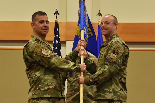 Lt. Col. Joseph Merrill, right, accepts command of the 341st Missile Security Forces Squadron from Col. Frank Reyes, 341st Security Forces Group commander during a change of command ceremony August 2, 2019, at Malmstrom Air Force Base, Mont.