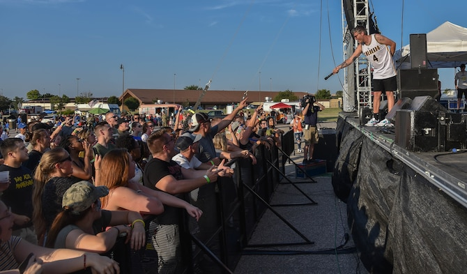 Sean Foreman, 3OH!3 vocalist, performs for a live crowd
