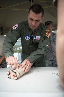 Lt. Col. Charles Biediger, a flight surgeon, assigned to the 149th Medical Group, Air National Guard, demonstrates the proper technique to suture a patient during a training exercise at Coast Guard Station Lake Tahoe, Nevada, June 16, 2019.