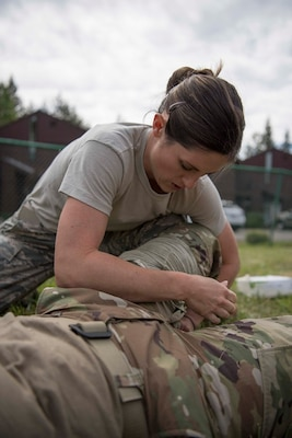 Staff Sgt Alisha Ayon, a medical technician assigned to the 149th Medical Group, applies a combat bandage during Tactical Combat Casualty Care training at Coast Guard Station Lake Tahoe, Nevada, June 16.