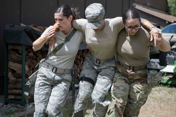 Staff Sgt. Alisha Ayon (left) and SSgt. Jennifer Hughes (right) carry Sgt. Kimberly Gaona to a medical evacuation area during Tactical Combat Casualty Care training at Coast Guard Station Lake Tahoe, Nevada June 16. all are members of the 149th Medical Group at Joint Base San Antonio-Lackland.