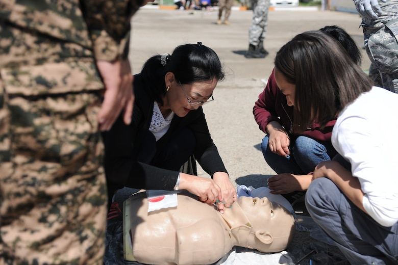 A participant in the trauma and mass casualty response training exercise practices providing emergency care on a medical mannequin, supervised by Mongolian Armed Forces and U.S. Air Force medical personnel in Bayongol Soum, Mongolia, July 26, 2019.